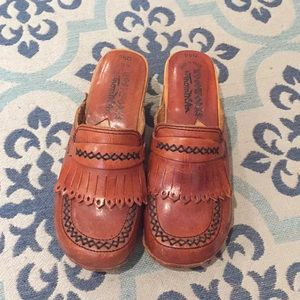 Vintage leather and wooden clogs